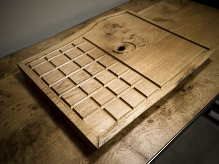 Large carving board made from English Oak with drainage grooves to capture all these tasty meat juices