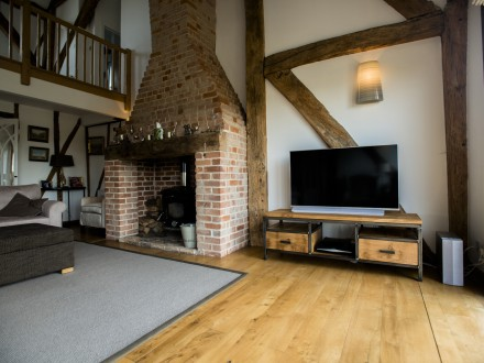 Bespoke, industrial TV cabinet made from solid English Oak and steel